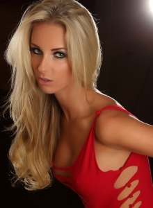 Blonde Alluring Vixen Babe Aneta Teases With Her Delicious Curves In A Very Skimpy Sexy Red Dress - Picture 3