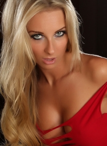 Blonde Alluring Vixen Babe Aneta Teases With Her Delicious Curves In A Very Skimpy Sexy Red Dress - Picture 11