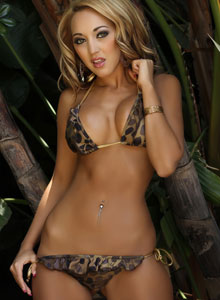 Alluring Vixen Ashley Shows Off In A Tiny Wild Themed Bikini - Picture 11