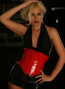 Blonde Alluring Vixen Babe Charlie Teases In Her Red Vinyl Corset As She Gets Topless - Picture 1