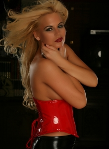 Blonde Alluring Vixen Babe Charlie Teases In Her Red Vinyl Corset As She Gets Topless - Picture 9