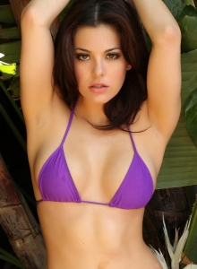 Alluring Vixen Tease Olivia Shows Off Her Delicious Curves In A Skimpy Purple String Bikini - Picture 1