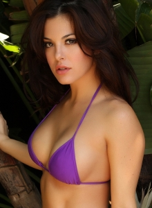 Alluring Vixen Tease Olivia Shows Off Her Delicious Curves In A Skimpy Purple String Bikini - Picture 4