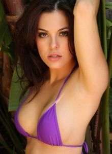 Alluring Vixen Tease Olivia Shows Off Her Delicious Curves In A Skimpy Purple String Bikini - Picture 5