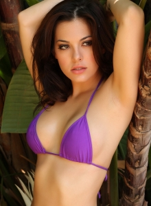 Alluring Vixen Tease Olivia Shows Off Her Delicious Curves In A Skimpy Purple String Bikini - Picture 7