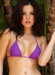 Alluring Vixen Tease Olivia Shows Off Her Delicious Curves In A Skimpy Purple String Bikini - Picture 8