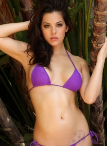 Alluring Vixen Tease Olivia Shows Off Her Delicious Curves In A Skimpy Purple String Bikini - Picture 9