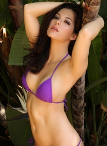 Alluring Vixen Tease Olivia Shows Off Her Delicious Curves In A Skimpy Purple String Bikini - Picture 11