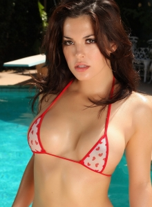 Stunning Busty Alluring Vixen Babe Olivia Shows Off By The Pool In A Skimpy String Bikini - Picture 1