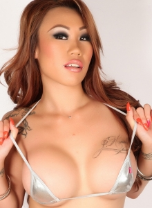 Busty Asian Babe Sally Teases In A Skimpy Silver String Bikini - Picture 2