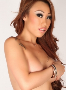 Busty Asian Babe Sally Teases In A Skimpy Silver String Bikini - Picture 8