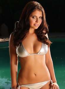 Alluring Vixen Cali Logan Poses By The Pool In A Very Tiny Silver Bikini - Picture 2