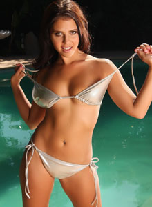 Alluring Vixen Cali Logan Poses By The Pool In A Very Tiny Silver Bikini - Picture 4