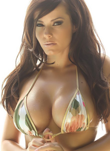 Busty Vixen Candace Shows Off Her Perfect Curves In A String Camo Bikini - Picture 2