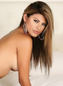 Alluring Vixen Claudia Teases In Just Panties As She Rolls Around In Bed Topless - Picture 3