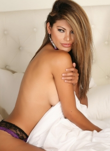 Alluring Vixen Claudia Teases In Just Panties As She Rolls Around In Bed Topless - Picture 7