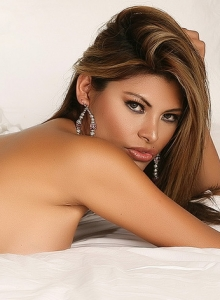 Alluring Vixen Claudia Teases In Just Panties As She Rolls Around In Bed Topless - Picture 11