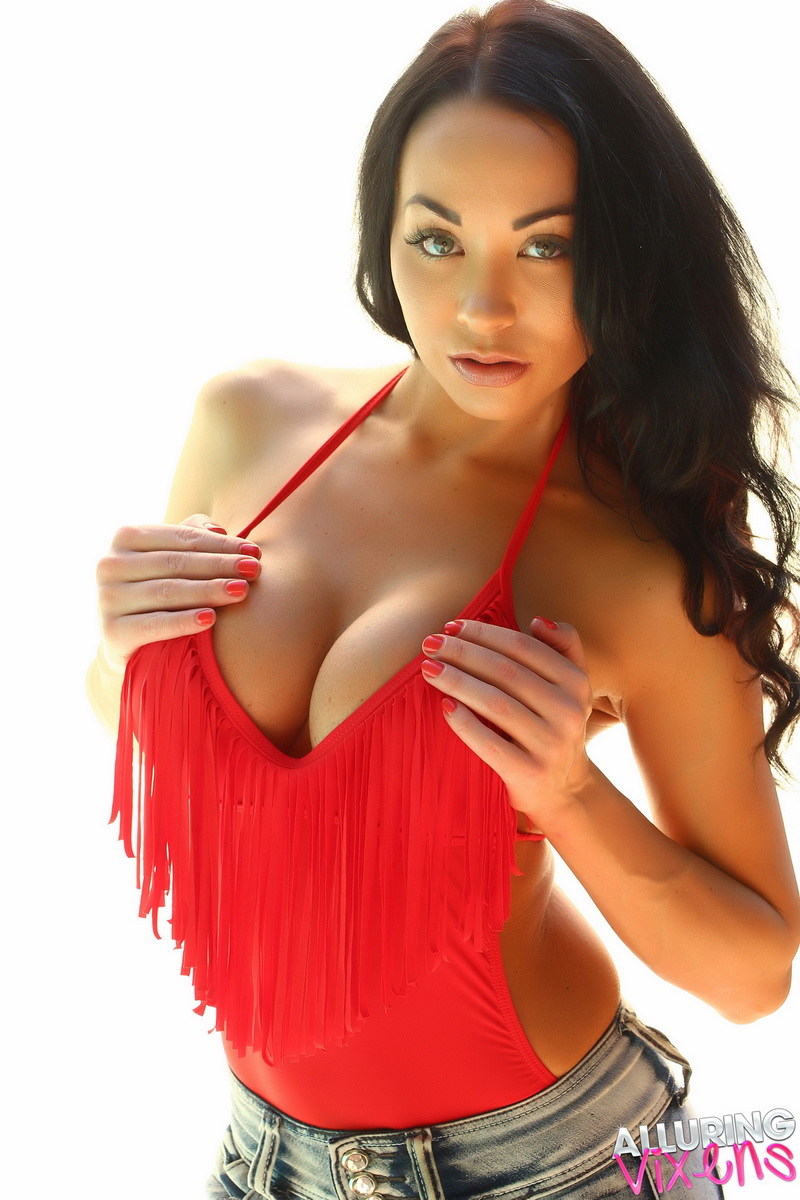Big breasted Alluring Vixen babe Jen teases with her huge boobs in her tight low cut red top
