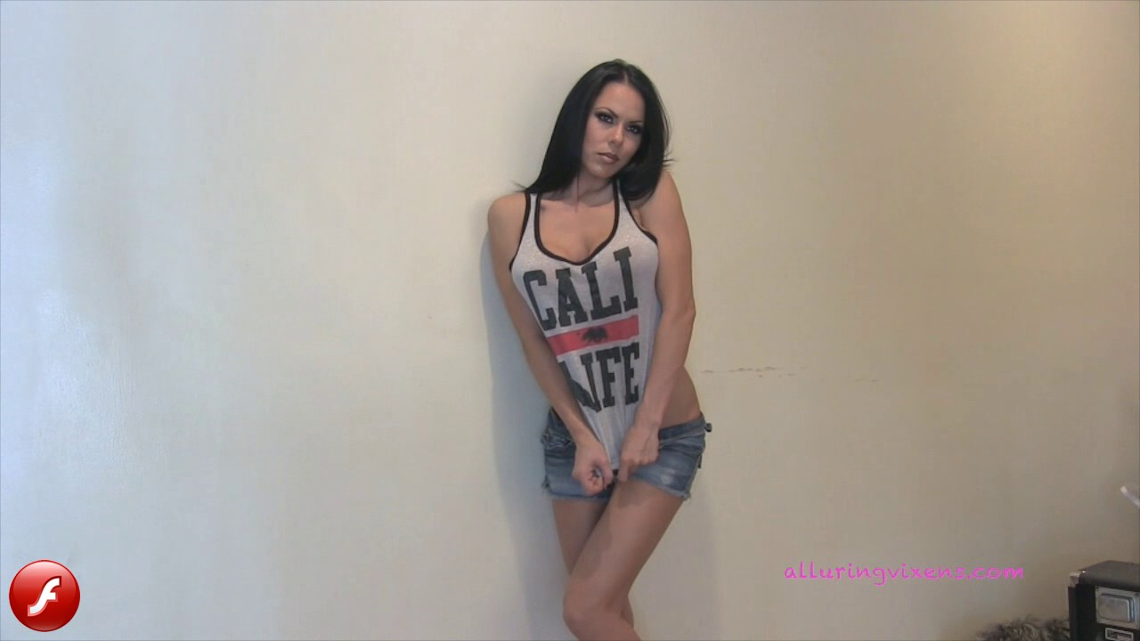 Watch as stunning Alluring Vixen babe Jennifer teases in her skimpy tank top and tiny jean shorts