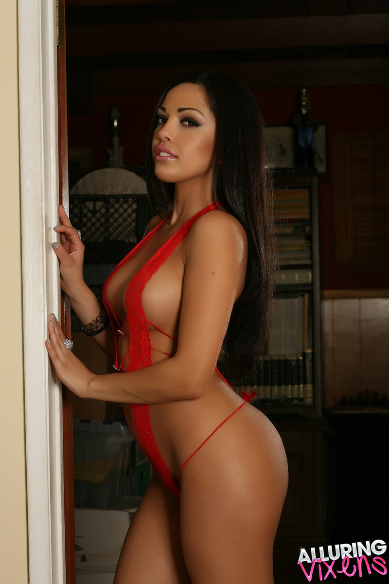 Sexy Alluring Vixen Karla shows off her perfect body in very skimpy red lace lingerie