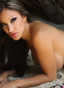 Sexy Vixen Kira Teases With A Little Sand On Her Big Juicy Tits - Picture 11
