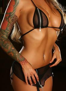 Megan Daniels Teases With Her Huge Boobs In A Zipper Bikini - Picture 4